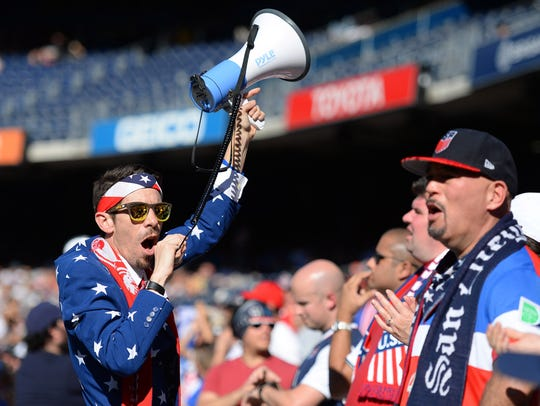 A United States fan leads the American Outlaws in a