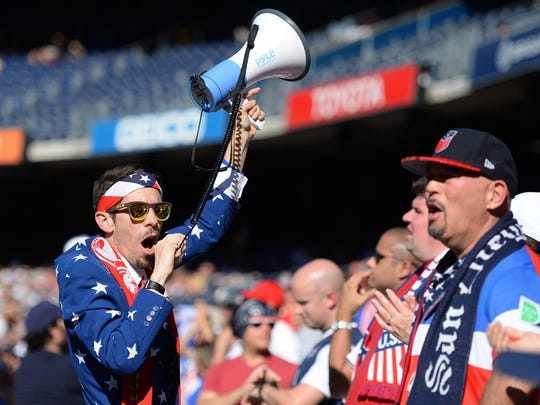 A United States fan leads the American Outlaws in a cheer during the first half against the Serbia at Qualcomm Stadium. Mandatory Credit: Jake Roth-USA TODAY Sports