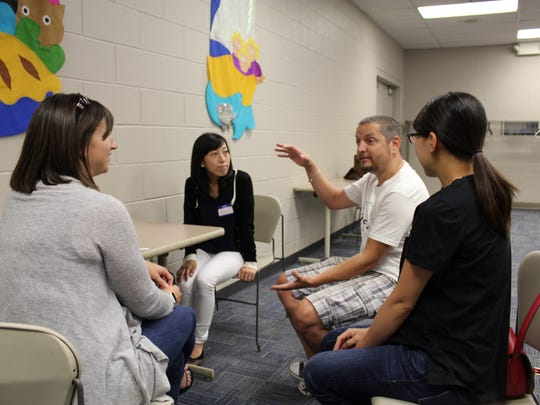 Members of the Northern Kentucky English Conversation Club meet every week to improve their knowledge of American culture and the quirks of the English language.  Seen here are, from left, Kana (Japan), Celso (Spain), Yuka (Japan) and Emily (back to pic), a native English speaker who volunteers to help guide the discussions.