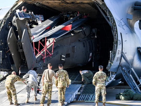Soldiers with the 101st Combat Aviation Brigade, 101st Airborne Division (Air Assault) and Airmen assigned to the 22nd Airlift Squadron, 60th Air Mobility Wing stationed at Travis Air Force Base, Calif., load an HH-60 medevac Blackhawk helicopter, Sept. 26, into a C-5M Super Galaxy at Campbell Army Airfield.  The helicopter is one of eight aircraft the division deployed to Puerto Rico, Sept. 27, as part of the Defense Department's Defense Support of Civil Authorities mission to support Hurricane Maria relief.