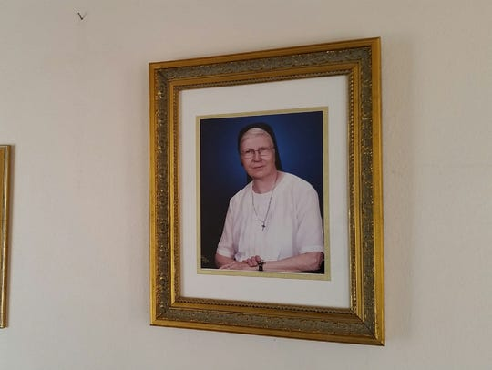 A photo of the late Sister Rita Keeven hangs on the