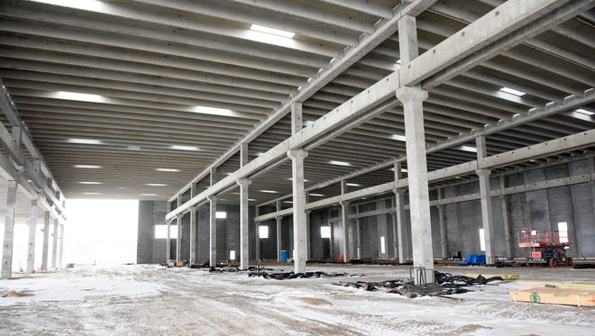 A new manufacturing facility for precast concrete panel producer Gage Brothers, sits partially constructed north of Sioux Falls. The new plant through increased use of automatization will allow the company to increase production by 60%.