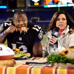 Then-Baltimore Ravens wide receiver Jacoby Jones eats turkey after a Thanksgiving game in 2013.