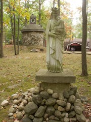 A sculpture of Mary and Jesus sits in front of a working lighthouse and boat-inspired home on Van Amberg Road in Brighton Township. The house was opened to the Livingston Daily for a tour Tuesday, Oct. 3, 2017.
