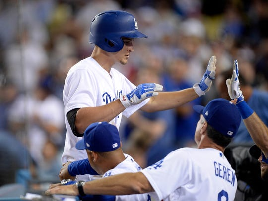 Los Angeles Dodgers shortstop Corey Seager is greeted
