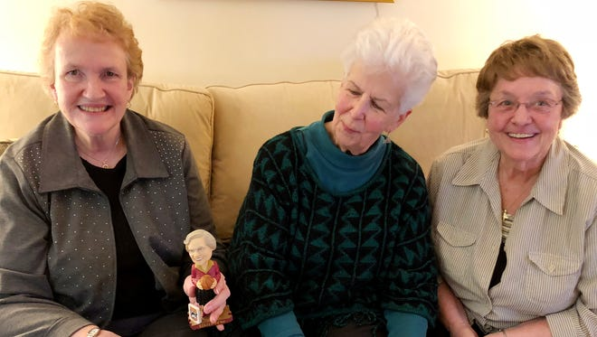 From left, Sister Peggy Geraghty, BVM Sister Mary Fran McLaughlin BVM Sister Diane O'Donnell, BVM With a bobble head of their friend Sister Jean, the team Chaplain for Loyola-Chicago as they watch the Sweet 16 game Thursday.