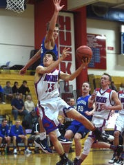 Reno's Christian Chamberlain (13) drives past Carson's Jayden DeJoseph (25) during their basketball game in Reno on Dec. 23, 2016.
