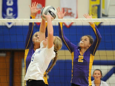 Unioto's Abbey Winegardner (2) attempts to block a kill try earlier this season.