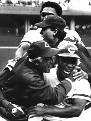 OCTOBER 13, 1976: ...Reigns Unrestrained, On The Field And Off It, As...Sparky Anderson, Rawly Eastwick, Tony Perez and Joe Morgan em-...at left following ninth inning victory. In center photo, Morgan, Pete Rose and Perez reach for Johnny Bench, whose homer has just tied the score. At right, Bob Bailey and Bill Plummer douse Bench with champagne.The Enquirer/Fred Straub