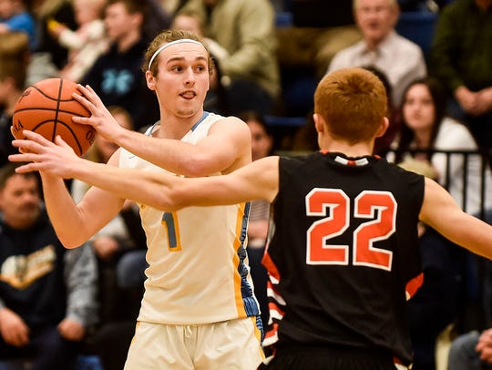 River Valley's A.J. Issler looks for an open man while