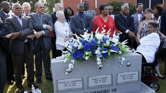 """Civil rights activists, from left front row, Bob Moses, Dave Dennis, Rita Schwerner Bender, Leroy Clemons, Myrlie Evers-Williams and U.S. Rep. John Lewis, D-Ga., gather outside Mt. Zion United Methodist Church in Philadelphia, Miss., June 15, 2014, and sing """"We Shall Overcome,"""" during a 50th anniversary commemorative service for three civil rights workers killed in Neshoba County for their work in voting rights. The rear row included civil rights leader Ed King, former Mississippi Gov. William Winter, Philadelphia Mayor James Young and Angela Lewis, the daughter of James Chaney. A wreath was placed on a marker honoring the three slain men, Chaney, Andrew Goodman and Michael Schwerner."""