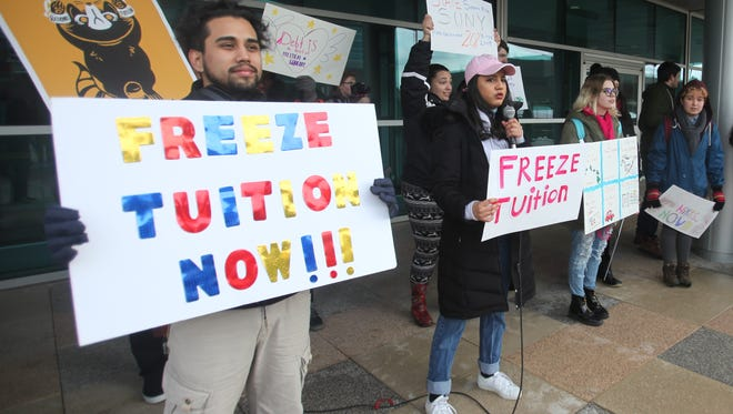 More than 60 students showed up for the rally for a tuition freeze on Friday by the SUNY Purchase Student Services building.