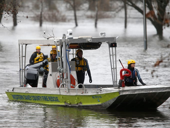 The Western Taney County water rescue team heads towards