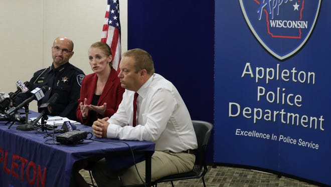Appleton Police Chief Todd Thomas, left, Outagamie County District Attorney Carrie Schneider, and Green Bay Police Department Lt. Rick Belanger, right, announce Lt. Jay Steinke was justified in fatally shooting Jimmy Montel Sanders, 33, at Jack's Apple Pub on May 21 during a press conference Friday in Appleton.