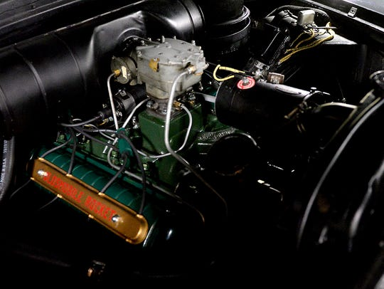 the Rocket 88 emblazoned engine of a 1950 Oldsmobile