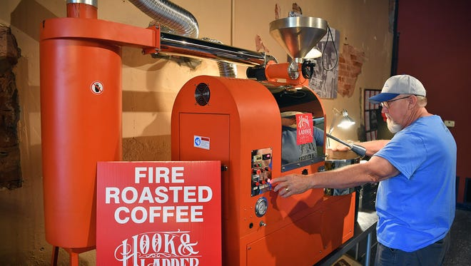 Bill Weske, a co-owner of Hook & Ladder Coffees and Winery, operates the coffee bean roasting machine at the business' location at 616 Seventh Street. A grand opening will be Friday at 11:00 a.m.