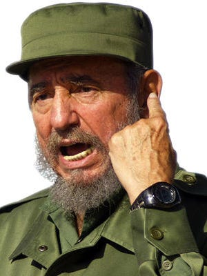 Former Cuban President Fidel Castro gestures during a speech Monday June 21,2004