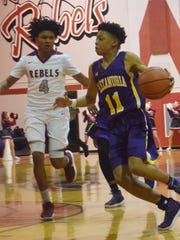 ASH sophomore Dez McQuain (11) goes for two points