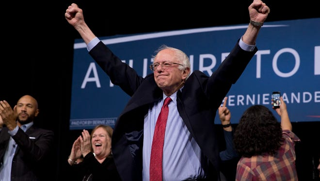 Democratic presidential candidate Sen. Bernie Sanders, I-Vt., center, acknowledges the cheering crowd after a rally Friday, Feb. 19, 2016, in Henderson, Nev.