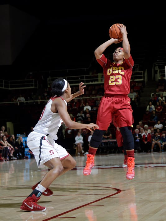 Southern California guard Brianna Barrett (23) shoots over a Stanford defender during the first half of an NCAA college basketball game on Friday, Feb. 13, 2015, in Stanford, Calif. (AP Photo/Marcio Jose Sanchez)