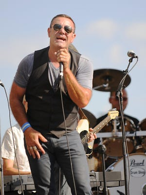 Mick Sterling and his band play a Bruce Springsteen tribute show in August 2015 at Takin' It To The Streets.