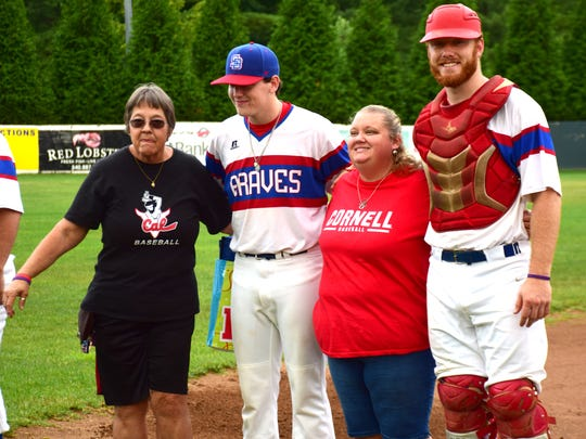 Kathy Martin, left, and her daughter Candice pose with the Staunton Braves players they hosted this summer, Bradyn Kail, second from left, and William Simoneit during Host Family Night ceremonies prior to the Braves' Valley Baseball League game against the New Market Rebels on Sunday, July 22, 2018, at John Moxie Memorial Stadium in Staunton, Va.