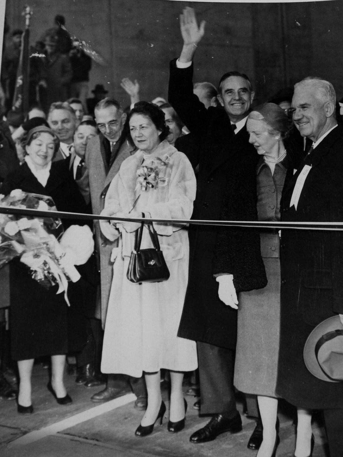 New York Gov. Averell Harriman waving, center, and Helen Hayes MacArthur, holding a bouquet at the far left, at the South Nyack ribbon-cutting that opened the Tappan Zee Bridge on Dec. 15, 1955. Marie Norton Harriman, the governor's wife, cuts the ribbon to open the bridge.