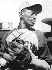 Hall of Famer Satchel Paige goes into his stretch on