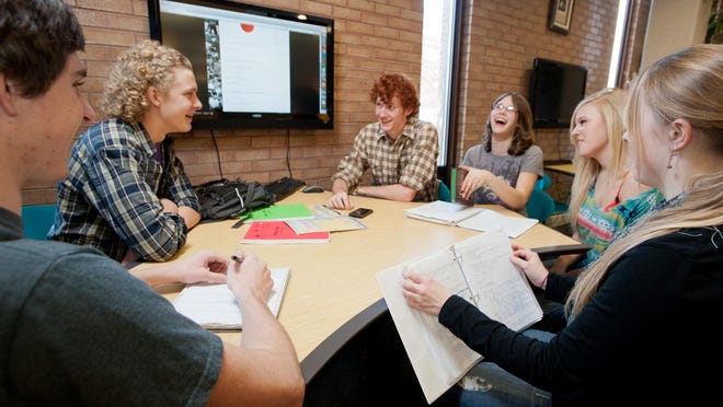 A group of University of Montana students study. Enrolled has continued to drop at UM.