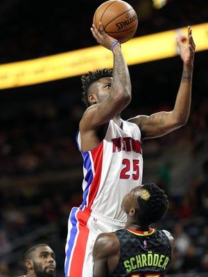 Jan 18, 2017; Auburn Hills, MI, USA; Pistons guard/forward Reggie Bullock drives to the basket as Atlanta Hawks guard Dennis Schroder defends during the first quarter  at the Palace.