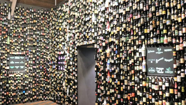 Hundreds of bottled beers are sorted by style. Visitors
