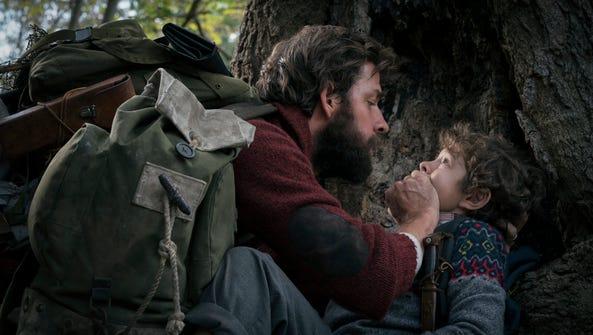 "John Krasinski, left, and Noah Jupe in ""A Quiet Place"""