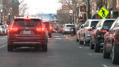 Cars roll along Broad Street in Red Bank hoping to