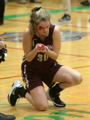 Pittsford Mendon's Caroline Cullinan (30) suffered a gash to her head after colliding with a Jamesville-DeWitt player during the girls Class A state championship game at Hudson Valley Community College in Troy on March 18, 2017.