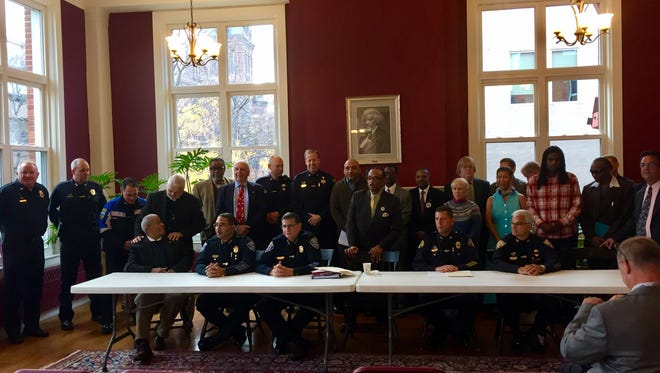 Area police chiefs, faith leaders and others joined together for a press conference on Friday.