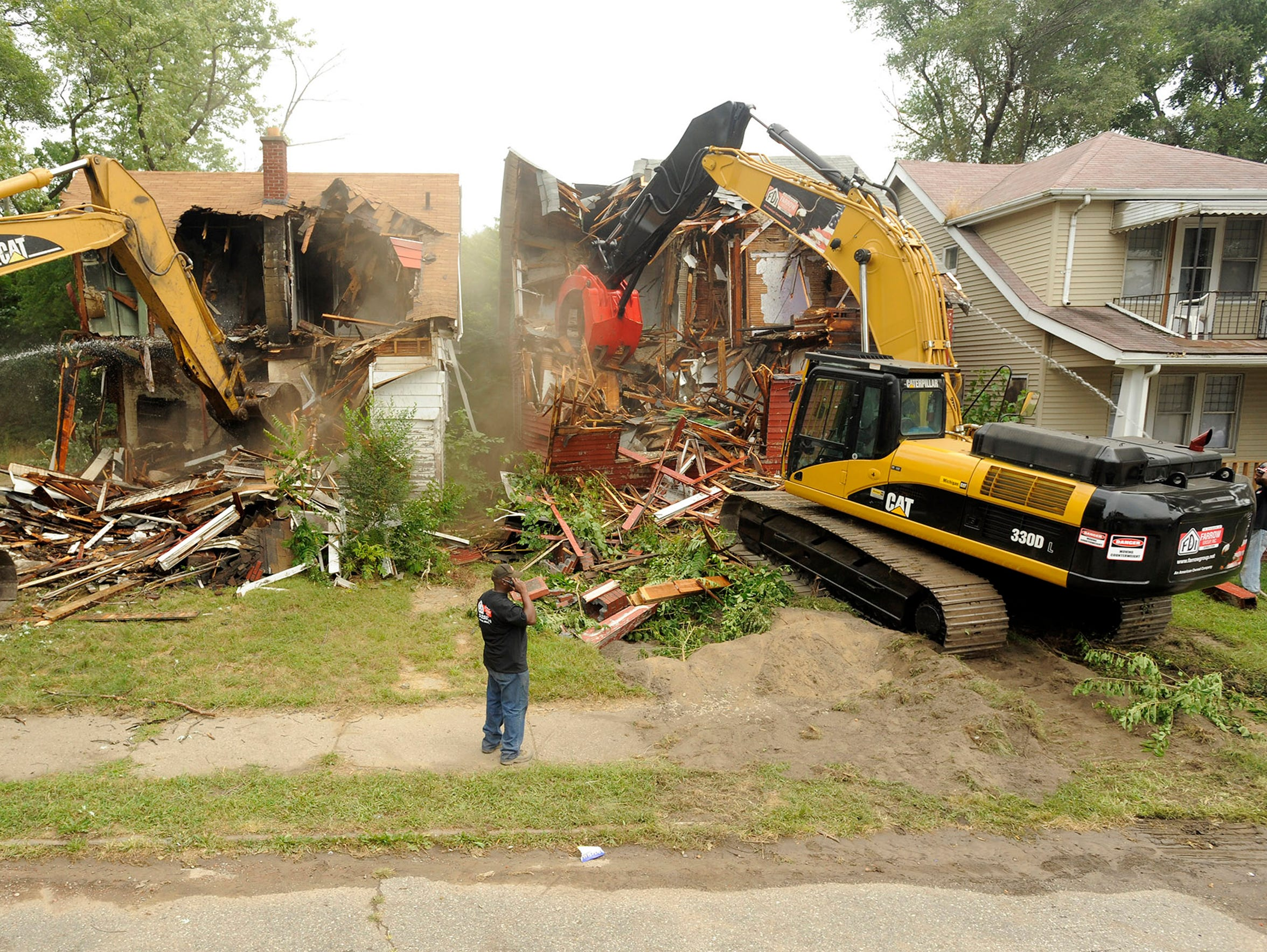 The city continues to raze homes, such as these on