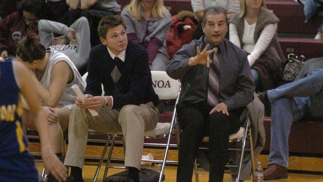 Genoa's Mike DeStazio, right, coaches from the bench in 2010. He earned his 100th victory at Genoa.