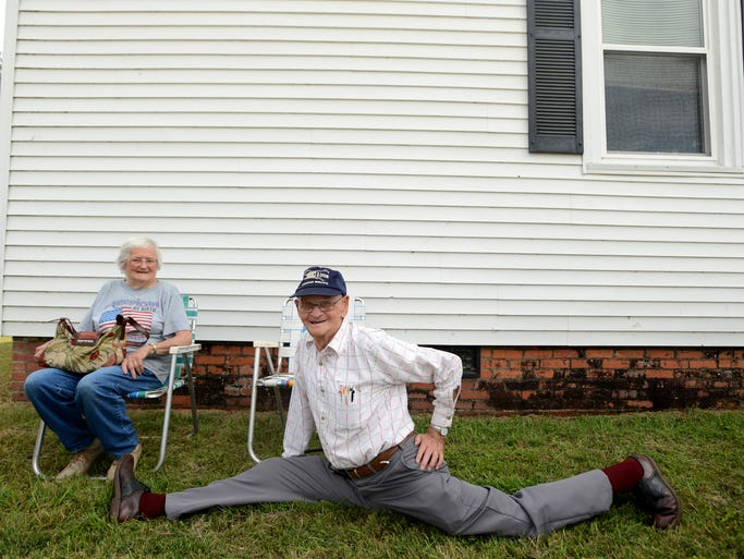 Earl Privitt, 90, shows off his stretching skills while waiting for the Three Way Labor Day stew sale, an annual tradition, at the Fairview Community Club. Proceeds of the Three Way sale benefit the Community Club.