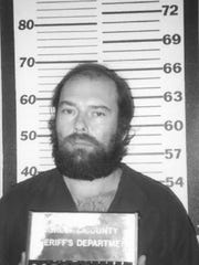 A 1993 booking photo of Frank Wright
