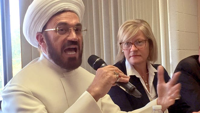 Mohammad Ali Elahi, Imam at the Islamic House of Wisdom in Dearborn Heights, and Barbara Niess-May of the SafeHouse Center in Ann Arbor, spoke out in favor of gun control legislation and decried gun violence in a panel with five Democratic U.S. Representatives at the Berkley Public Safety Building on June 29, 2016.