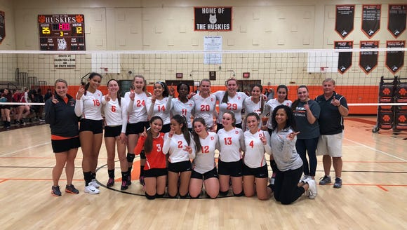 The Dumont girls volleyball team clinched at least