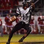 Parkway quarterback Keondre Wudtee looks to throw to a receiver against Haughton.