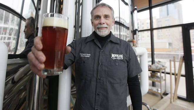 Brewmaster Richard Dube holds a glass of beer at the Moerlein Lager House at The Banks.