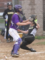 Nanuet's Tara Connolly scores in front of Clarkstown North catcher Halle Medici on April 22, 2017.