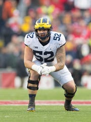 Michigan Wolverines offensive lineman Mason Cole was taken by the Cardinals in the third round of the 2018 NFL draft.