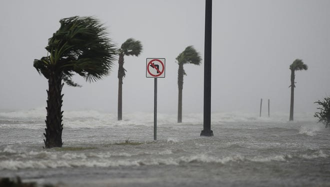 Storm surge from Hurricane Isaac crosses U.S. 90 in Gulfport