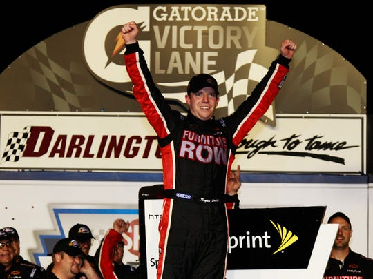 Regan Smith celebrates after winning the SHOWTIME Southern 500 at Darlington Raceway in 2011. (Chris Graythen/Getty Images)