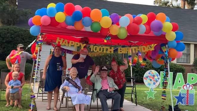 Nellie and Billy Jones celebrate turning 100 years old together with their family.