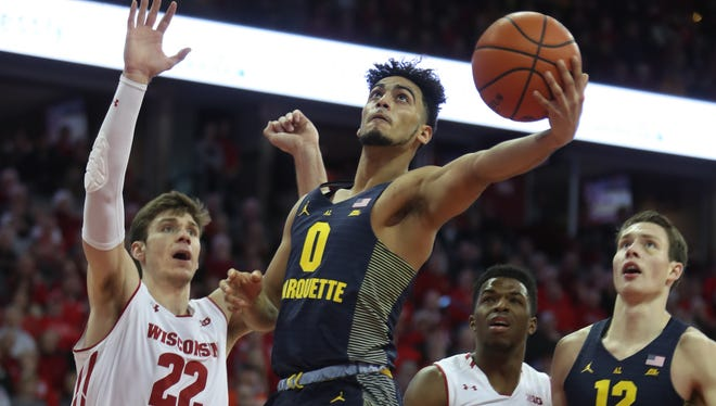 Marquette's Markus Howard goes to the basket against Wisconsin's Ethan Happ. Both players are their respective team leaders heading into Saturday's game.