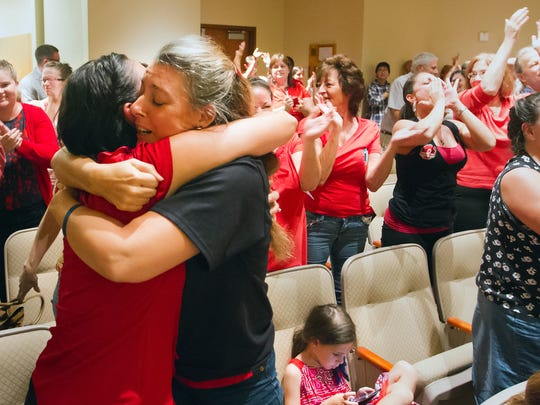 KINFAY MOROTI/THE NEWS-PRESS.. Rita Giddens, left, and Tess Brennan celebrate the Lee County School Board opting out of Common Core testing Wednesday (8/27/14) during a school board meeting in Fort Myers. Lee County is the first in Florida to opt out of Common Core testing.